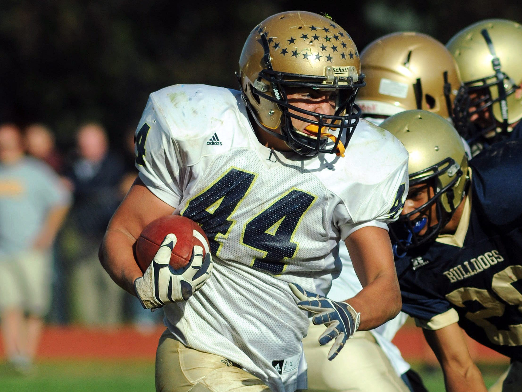 Our Lady of Lourdes' Jacob Wiegard runs the ball on Oct. 20, 2012, in the Warriors' last game against Beacon before Saturday.
