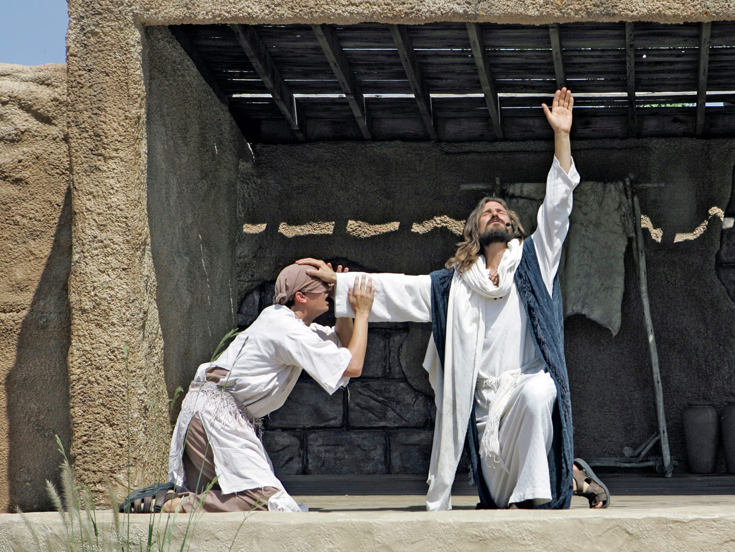Les Cheveldayoff (right) portrays Jesus during a performance