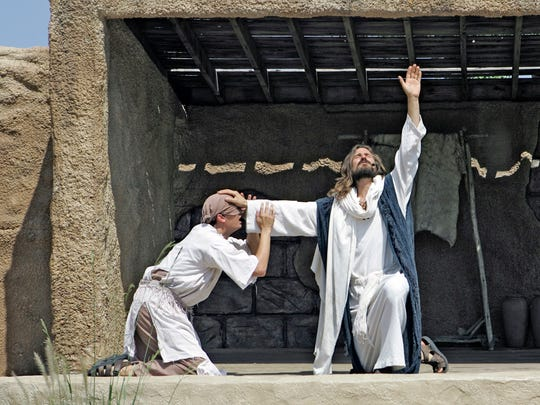 Les Cheveldayoff (right) portrays Jesus during a performance called the Ministry of Jesus at the Holy Land Experience in Orlando.