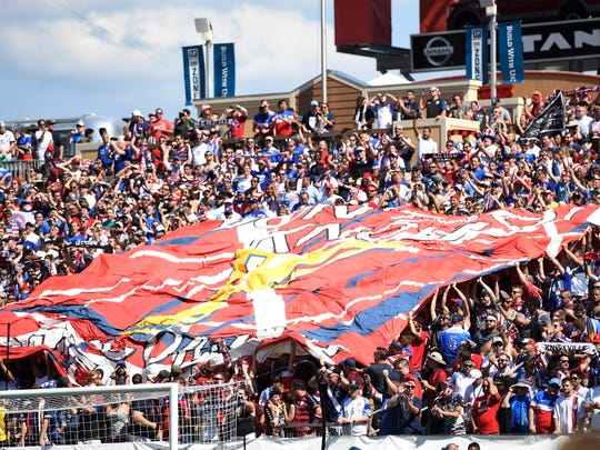 American Outlaws unfurl a banner before the start of the CONCACAF Gold Cup soccer game at Nissan Stadium Saturday, July 8, 2017, in Nashville, Tenn.