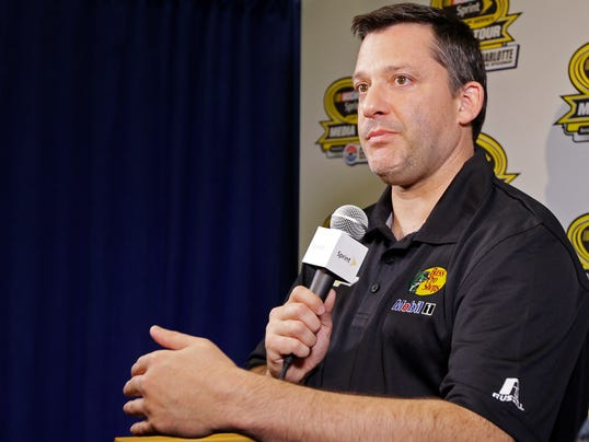 Tony Stewart answers a question during a news conference at the NASCAR