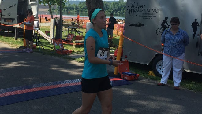 Sarah Cottone, 22, of East Satauket, finishes the Broome County Triathlon on June 25, 2016, at Dorchester Park in Whitney Point.