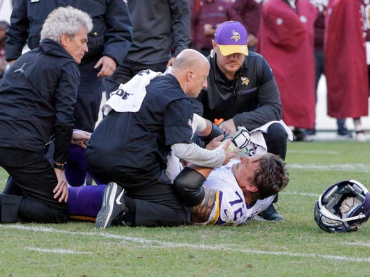 FILE - In this Nov. 13, 2016, file photo, Minnesota Vikings offensive tackle Jake Long (72) is helped up after an injury during the second half of an NFL football game against the Washington Redskins,  in Landover, Md. Another loss has triggered another round of changes for Minnesota, with new kicker Kai Forbath leading the list as the Vikings try to stop their freefall by letting the struggling Blair Walsh go. They also have another new tackle, Rashod Hill, after losing yet another one, Jake Long, for the season. (AP Photo/Mark Tenally, File)