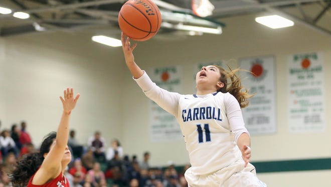 Carroll's Bianca Flores lays the ball in the basket against Ray during the 30-5A championship on Thursday, Feb. 9, 2017, at King High School in Corpus Christi.