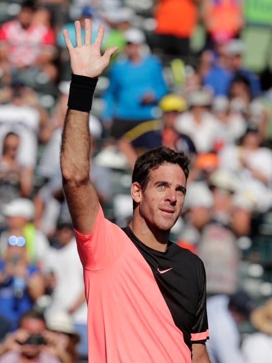 Juan Martin del Potro, of Argentina, waves after defeating Kei Nishikori, of Japan, during the Miami Open tennis tournament, Sunday, March 25, 2018, in Key Biscayne, Fla. Del Potro won 6-2, 6-2. (AP Photo/Lynne Sladky)