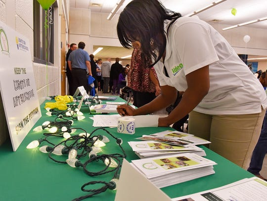 Fannie Craft signs a petition in favor of the Afterschool