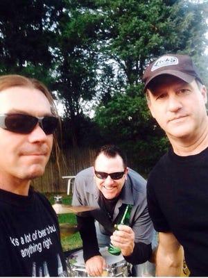 Bassist Al Gedney (right), drummer Matt Frick (center) and bassist Mike Martin of Newark rock band Jones Alley.