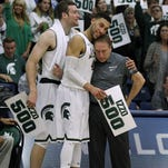 Michigan State coach Tom Izzo, right, gets a hug from guard Denzel Valentine, who is next to forward Matt Costello, after Izzo's 500th career win Thursday during a 99-68 victory over Boston College in the quarterfinals of the Wooden Legacy tournament in Fullerton, Calif.