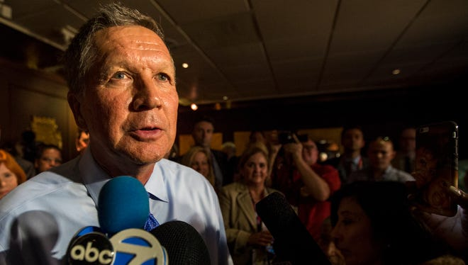 Ohio Gov. John Kasich speaks to delegates from Illinois at a steakhouse in Cleveland on the first day of the Republican National Convention. Because of his opposition to Republican nominee Donald Trump, Kasich attended delegate events like this one instead of going to the convention hall.