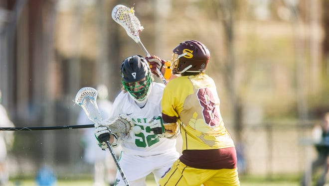 York College's Austin Glab (52) loses possession after a check by Salisbury University's Preston Dabbs (8) and another stick during a Capital Athletic Conference men's lacrosse game at York College on Wednesday. The Spartans lost 17-5.
