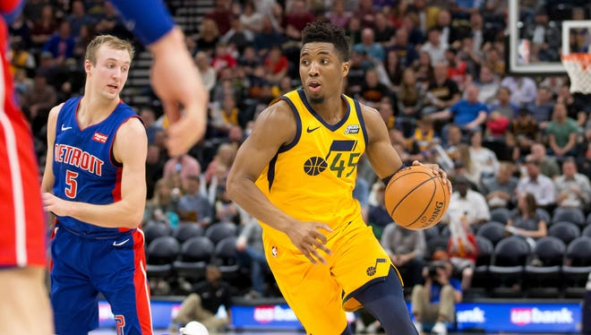 Mar 13, 2018; Salt Lake City, UT, USA; Donovan Mitchell dribbles past Luke Kennard during the second half of the Pistons' 110-79 loss to the Jazz.