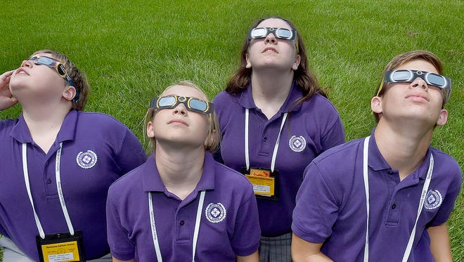 Seventh-grade students from Opelousas Catholic are prepared for Monday's eclipse.