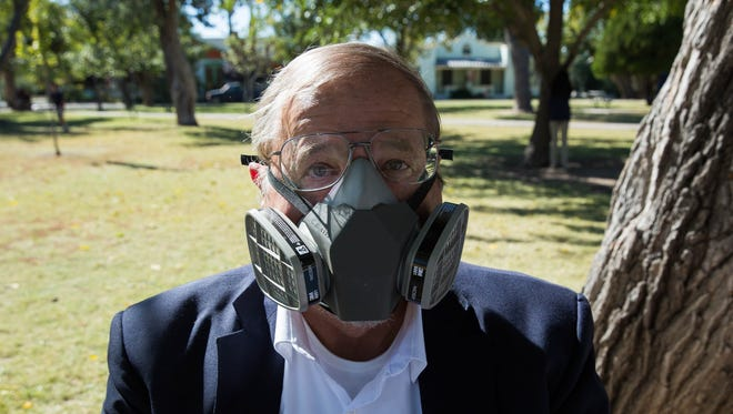 Las Crucen Fred Neumann has severe chemical sensitivities, but has learned to live with them. Pictured here at Pioneer Women's Park, Neumann demonstrated a mask he sometimes has to wear when out in public to protect himself from chemicals he might be sensitive to.