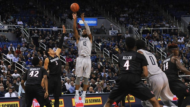 Nevada's D.J. Fenner shoots while taking on San Diego State during their basketball game at Lawlor Events Center on Wednesday.