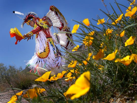 Victor Estorga dances among the poppies Saturday during the 2016 Poppy Festival at the El Paso Museum of Archaeology. The festival celebrates the beauty of the poppies on the northeast side of Transmountain Drive. Music, food and activities were available as well as Native American dancing by Boy Scouts Adventure Crew 66.