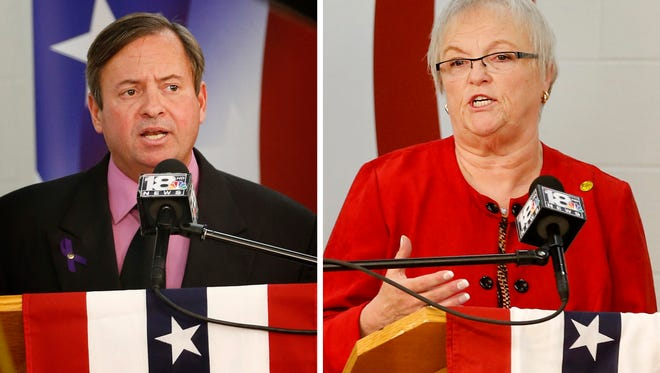 A composite photo of Elmira mayoral candidate Dan Mandell and incumbent Sue Skidmore shows moments during a debate Wednesday evening where they defended their candidacy and declared why they would be the best mayor.