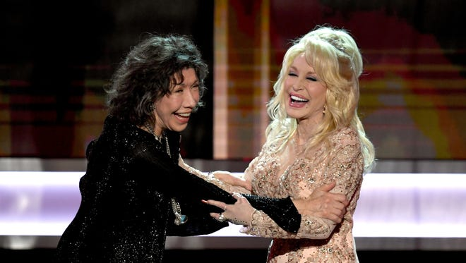 Lily Tomlin, left, accepts the 2016 SAG Life Achievement Award from actor/singer Dolly Parton onstage during the 23rd Annual Screen Actors Guild Awards at The Shrine Auditorium on Jan. 29, 2017 in Los Angeles.