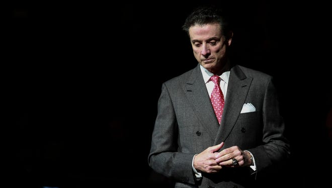 Louisville basketbal coach Rick Pitino before before the start of the match-up with visiting Savannah State on Monday evening at the KFC Yum! Center. Nov. 24, 2014