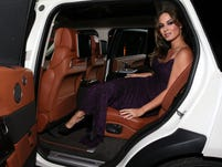 Berenice Marlohe, who appeared in the James Bond movie 'Skyfall' to see the $199,000 vehicle at a Beverly Hills estate