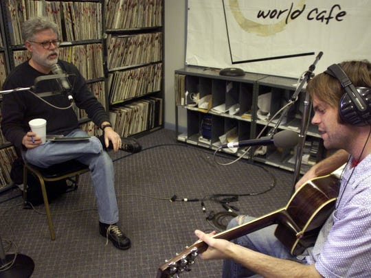"""World Cafe"" host David Dye (left) speaks with guest artist Neil Halstead in the studios of WXPN in 2002."