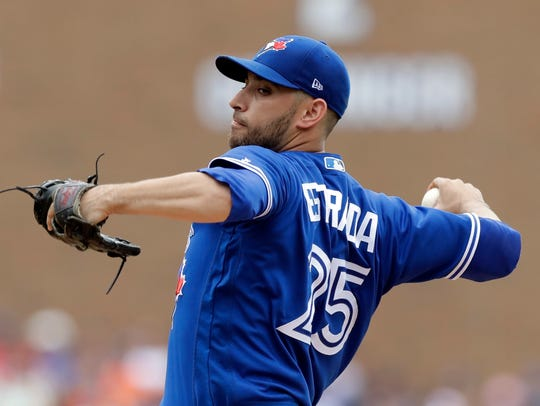 Blue Jays starting pitcher Marco Estrada throws during