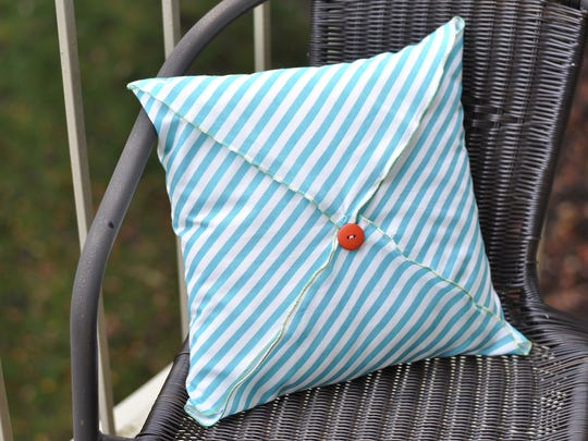 This DIY pillow case will add inexpensive flair to your living room.