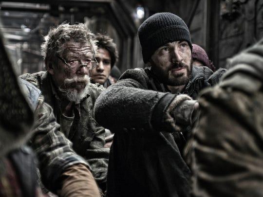 John Hurt and Chris Evans in a scene from 'Snowpiercer.'