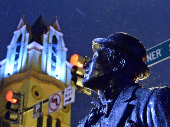 The statute of William Whitner in downtown Anderson, where people leave scarves and other warm gear for the needy, is beginning to be covered in snow.