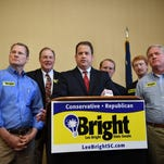 Sen. Lee Bright, center, speaks during a Spartanburg press conference where a number of conservative legislators spoke in support of his campaign on Tuesday. Bright is facing Scott Talley in a primary runoff.