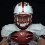 Stanford Cardinal running back Christian McCaffrey poses with Nike logo gloves during Pac-12 media day at Hollywood & Highland.