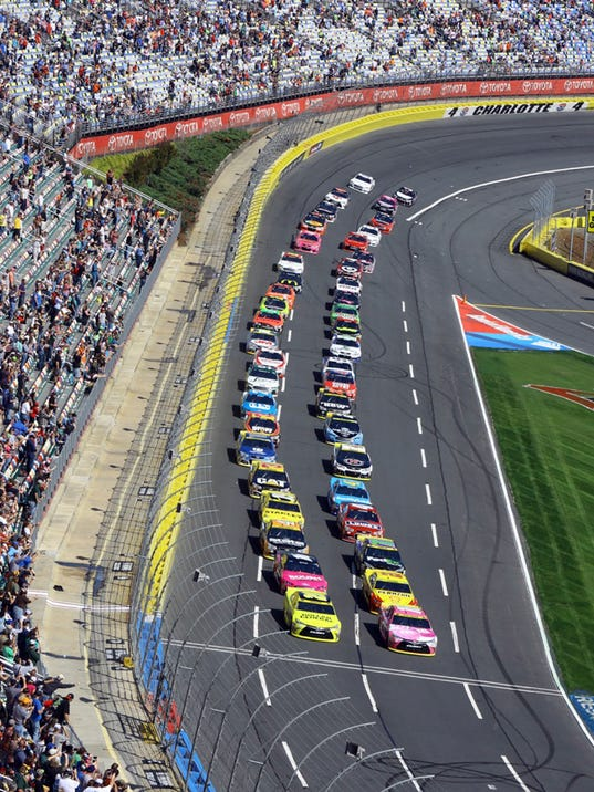The field of cars come out of Turn 4 at the start of the NASCAR Sprint Cup series auto race at Charlotte Motor Speedway in Concord, N.C., Sunday, Oct. 11, 2015. (AP Photo/David Graham)
