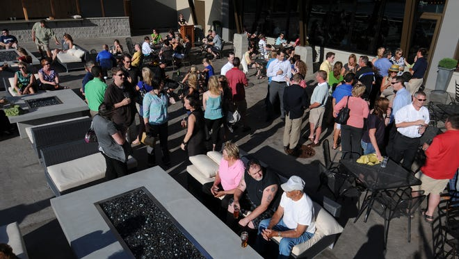 Patrons fill the outdoor deck at Hagemeister Park in Green Bay.