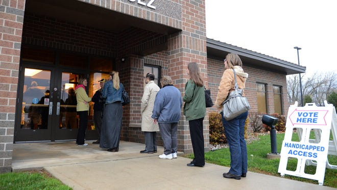 Voters line up at the polling station at the Allouez Village Hall on Tuesday morning, Nov. 4, 2014.