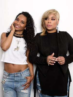 """In this June 9, 2017 photo, Rozonda """"Chilli"""" Thomas, left, and Tionne """"T-Boz"""" Watkins of TLC pose for a portrait in New York to promote their self-titled album. (Photo by Taylor Jewell/Invision/AP)"""
