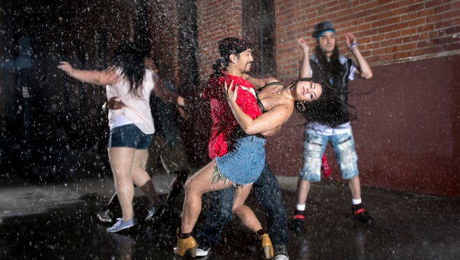 The electricity is off which means no air conditioner in the middle of a scorching summer. Washington Heights residents improvise with a busted fire hydrant. From left to right: Nina (Velvet Piini), Benny (William Carl Stallings III), Usnavi (Chris Marcos), Vanessa (Heather Mae Steffen), Graffiti Pete (Nico) in Lin-Manuel Miranda's 'In the Heights', The Western Stage, 2017