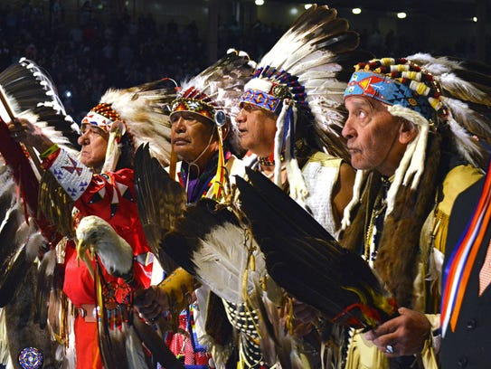 A group of Native American elders lead the grand entry