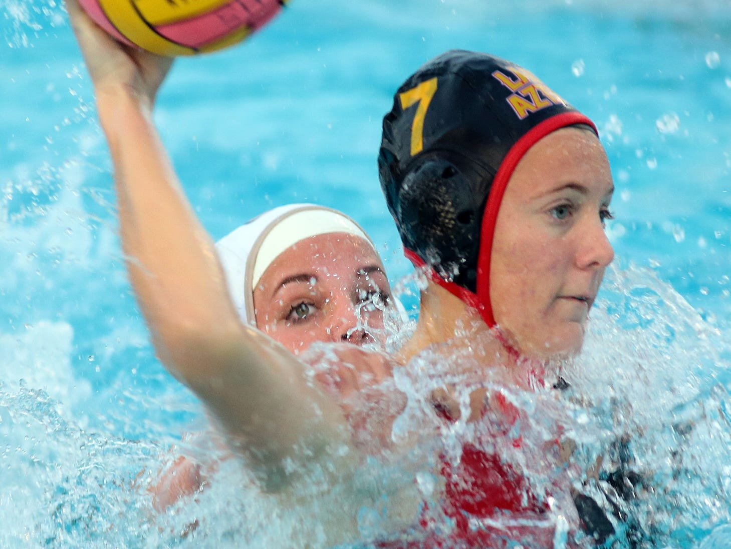 Palm Desert's Elise Stein (black cap) plays during a CIF playoff game against the Citrus Valley Blackhawks (white caps) on Wednesday, February 18, 2015. Palm Desert won 14-4.