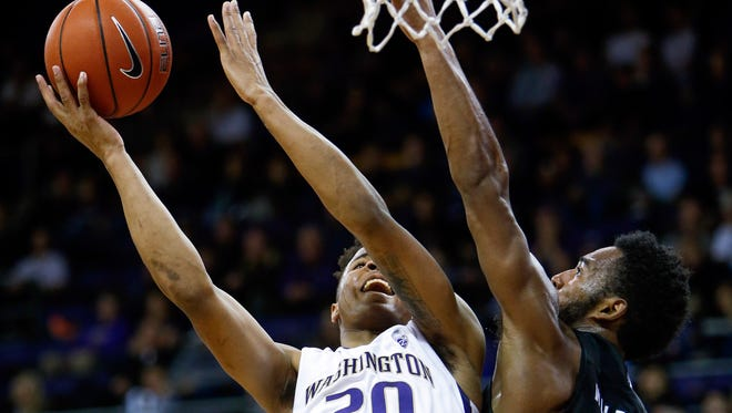 Nevada's D.J. Fenner contests a shot by Markelle Fultz on Sunday at Washington. Fenner grew up in Seattle and scored 20 points in his homecoming game.
