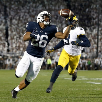 Penn State's Saquon Barkley (26) gains control of a