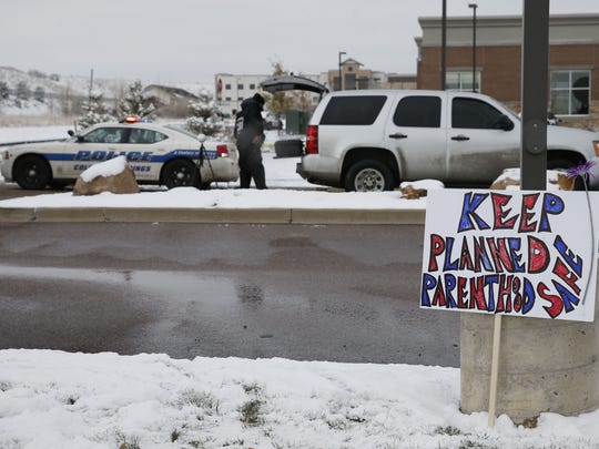 A sign in support of Planned Parenthood stands just