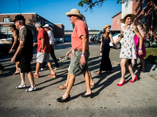 Dozens of plucky men donned go-go boots, kitten heels and pumps in Hanover on Friday to take a stand against domestic violence in the annual Walk a Mile in Her Shoes march. (Shane Dunlap -- The Evening Sun)