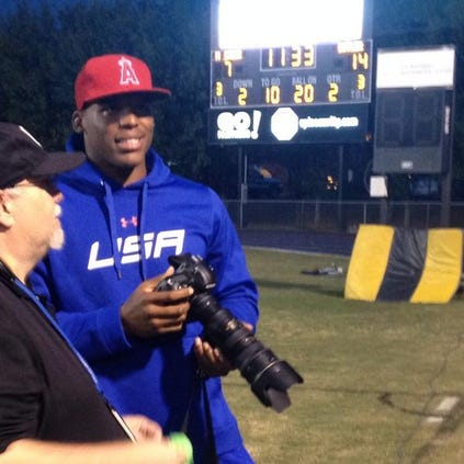 Surprise! Cam Newton shows up at Friday night fooball