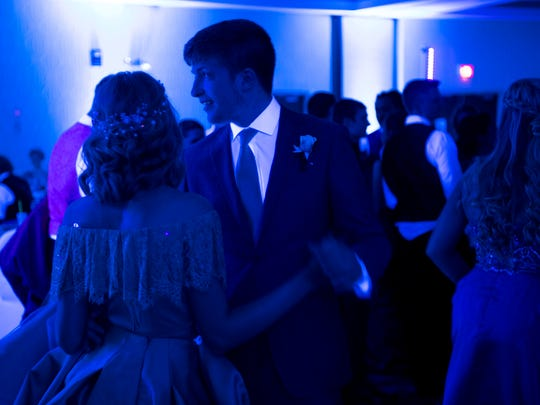 Couples take the dance floor at the Tecumseh High School