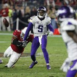 Arizona Cardinals inside linebacker Dwight Freeney (54) forces Minnesota Vikings quarterback Teddy Bridgewater (5) to fumble during the second half of an NFL football game, Thursday in Glendale, Arizona. The Cardinals recovered the ball to secure the 23-20 win.