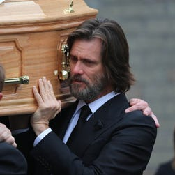 Actor Jim Carrey, carries the coffin of his ex-girlfriend Cathriona White as they walk to Our Lady of Fatima Church, in her home village of Cappawhite, County Tipperary, Ireland, on Saturday.
