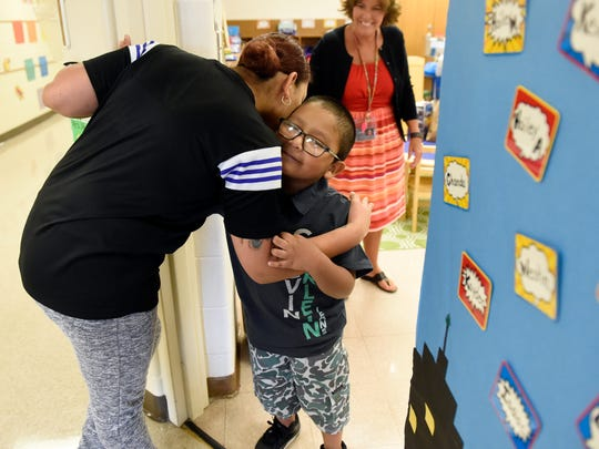 Kevin Murillo gets a hug and kiss from his mother Miriam