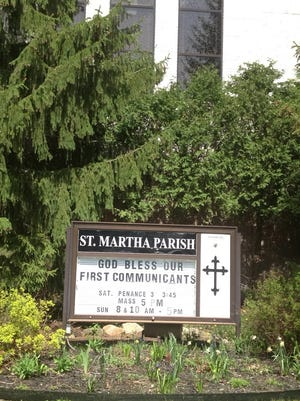 "St. Martha Catholic Church in Okemos. The Reverend Jonathan Wehrle, pastor at St. Martha, is on administrative leave during an investigation into a ""possible significant embezzlement"" according to the Catholic Diocese of Lansing."