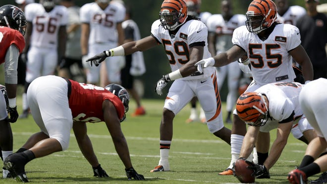 Emmanuel Lamur (59) and Vontaze Burfict (55) line up during a drill against the Falcons during training camp in 2013. That was the last time the Bengals took part in joint practices.
