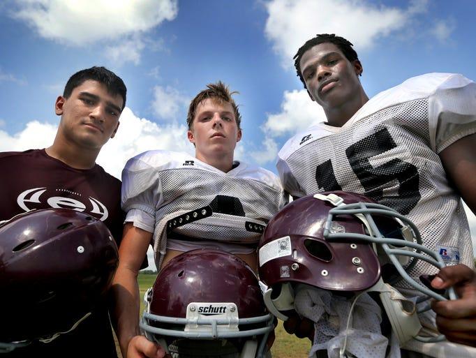 Eagleville running backs (L to R) Jesse Farrar, Wes Vallance, and Rodney Turner after football practice on July 22, 2014.