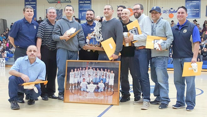 The 1996 state basketball team from Silver High was honored at halftime Friday night. The team went 24-3 that season to win the Class 3A state crown.
